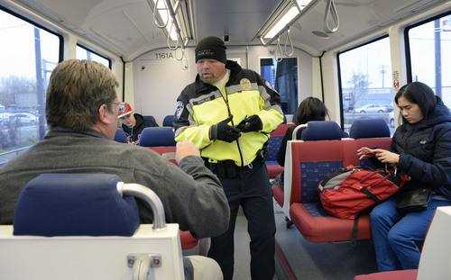 Al Hartmann  |  The Salt Lake Tribune UTA police officer Steve Rowland checks passengers on a TRAX train for  tickets.  You never know where or when along bus or TRAX lines where they will appear to check for your  ticket.