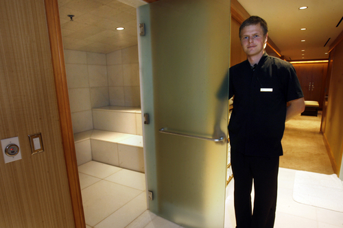 Scott Sommerdorf   |  The Salt Lake Tribune Spa Concierge Dima Memedov opens the door to the men's steam room at The Grand Spa at the Grand America Hotel.