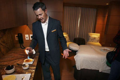 Scott Sommerdorf   |  The Salt Lake Tribune Spa Director Tony Fountain prepares creme brulee,  which is served  prior to the couples massage  at the Grand Spa.