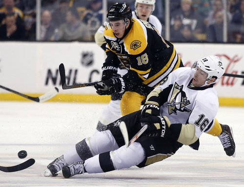 Pittsburgh Penguins left wing James Neal (18) loses his edge while chasing the puck against Boston Bruins right wing Reilly Smith (18) in the second period of an NHL hockey game in Boston, Monday, Nov. 25, 2013. (AP Photo/Elise Amendola)