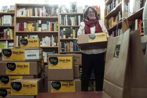 Chris Detrick  |  The Salt Lake Tribune King's English owner Betsy Burton gives volunteers boxes of books that will be given out on World Book Night at The King's English Bookshop Thursday April 19, 2012. On April 23, 6,000 cities in America will participate in World Book Night. 25,000 volunteers will give away half a million free books that day.