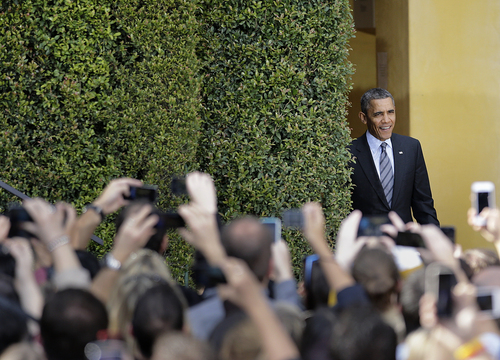 President Barack Obama arrives to speak at the DreamWorks Animation studio on Tuesday, Nov. 26, 2013, in Glendale, Calif. Obama is wrapping up a three-day West Coast tour by making an economic pitch at the studio of movie producer Jeffrey Katzenberg, one of his top fundraisers and political supporters.(AP Photo/Jae C. Hong)