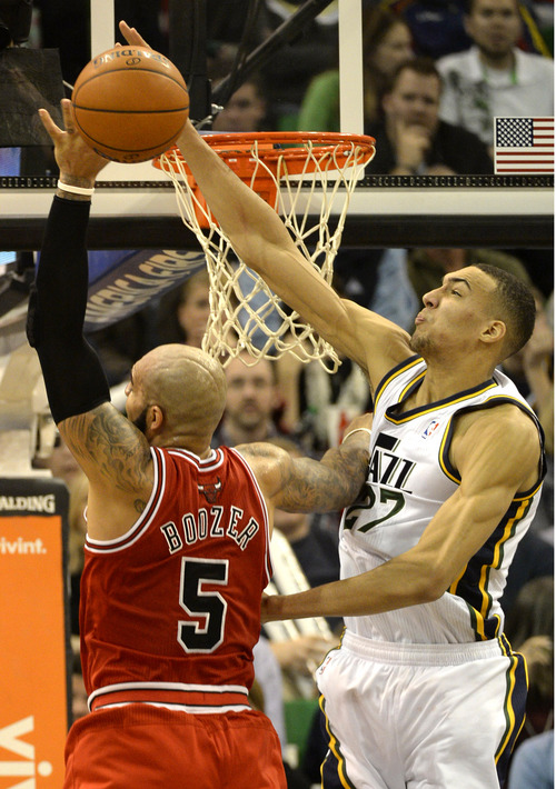 Rick Egan  | The Salt Lake Tribune   Utah Jazz center Rudy Gobert (27) blocks a shot by Chicago Bulls power forward Carlos Boozer (5), in NBA action, as the Jazz faced the Chicago Bulls, at the EnergySolutions Arena, Monday, November 25, 2013.