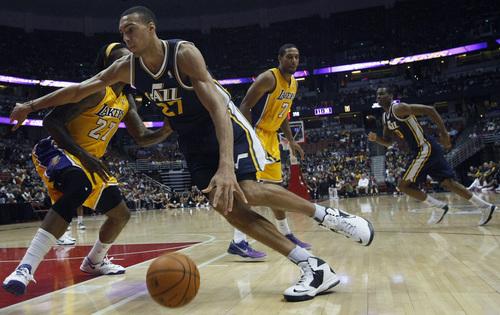 Chris Detrick  |  The Salt Lake Tribune Utah Jazz center Rudy Gobert (27) runs around Los Angeles Lakers center Jordan Hill (27) during the game at the Honda Center Arena in Anaheim, California Friday October 25, 2013.