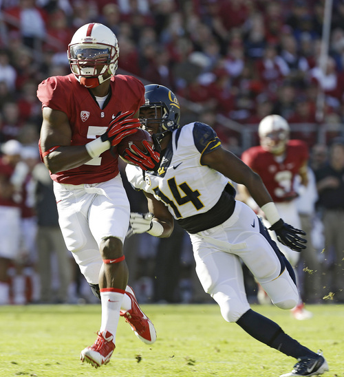Stanford wide receiver Ty Montgomery (7) catches a touchdown pass against California cornerback Cameron Walker (14) during the first half of an NCAA college football game in Stanford, Calif., Saturday, Nov. 23, 2013. (AP Photo/Tony Avelar)