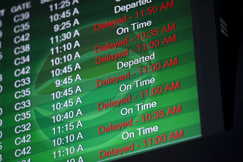 An airport monitor shows that a number of flights are delayed at Tampa International Airport, Tuesday morning, Nov. 26, 2013, in Tampa, Fla. Travelers are facing delays due to winter storms in other areas of the country.  (AP Photo/The Tampa Bay Times, Eve Edelheit) TAMPA OUT; CITRUS COUNTY OUT; PORT CHARLOTTE OUT; BROOKSVILLE HERNANDO OUT; USA TODAY OUT; MAGS OUT