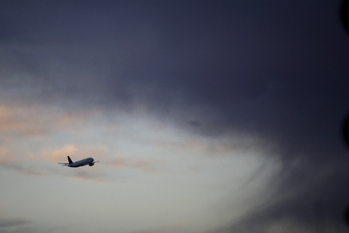 A United Airlines flight takes off from the Los Angeles International Airport on Wednesday, Nov. 27, 2013, in Los Angeles. More than 43 million people are to travel over the long holiday weekend, according to AAA. (AP Photo/Jae C. Hong)