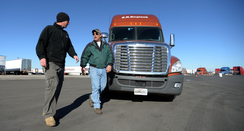 Steve Griffin  |  The Salt Lake Tribune  Todd Dameron, a backing instructor for C.R. England Trucking, right, works with lead backing instructor, Mike Bemis, as they practice a straight line back up at C.R. England's driving course in Salt Lake City Monday, Nov. 18, 2013. The company is looking to hire 3,500 military veterans this year as drivers. Dameron is a Marine veteran who served from 1983-1990 and Bemis is an Army veteran who served from 2003-2009.