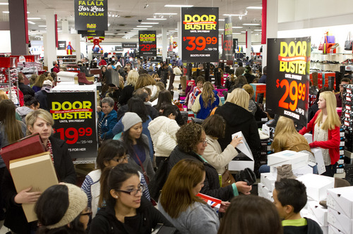 Jeremy Harmon  |  The Salt Lake Tribune  Shoppers pack the shoe aisle at JC Penney Valley Fair Mall location in West Valley as the store opens on Thanksgiving Day, Thursday, November 28, 2013.