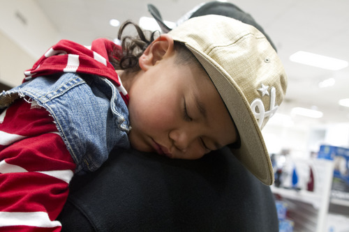 Jeremy Harmon  |  The Salt Lake Tribune  Four-year-old Sa'a Talanoa sleeps on the shoulder of his father Bernard Talanoa as the family shops at JC Penney Valley Fair Mall location in West Valley as the store opens on Thanksgiving Day, Thursday, November 28, 2013.
