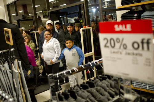 Jeremy Harmon  |  The Salt Lake Tribune  Shoppers crowd through the doors at JC Penney's Valley Fair Mall location in West Valley as the store opens on Thanksgiving Day, Thursday, November 28, 2013.