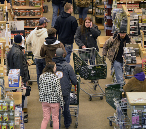 Al Hartmann  |  The Salt Lake Tribune First shoppers enter Cabela's in Lehi Friday November 29 as the store opened at 5 a.m.  Even though there were thousands lined up to get in there was no mad rush to get through the doors.  Shoppers entered in a controlled way through one door for a safe experience.