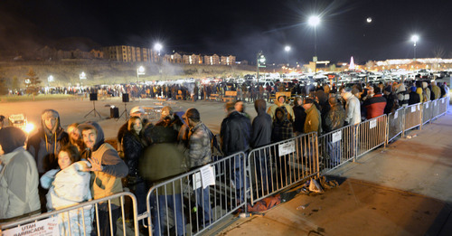 Al Hartmann  |  The Salt Lake Tribune People lined up in front of Cabela's in Lehi Friday November 29 to enter the store at 5 a.m. when the doors open. The store estimated about 4,000 folks lined up in a line that stretched around three sides of the building. Many received prizes for waiting in line.   Those towards the front of the line arrived on Thursday morning and camped out overnight.