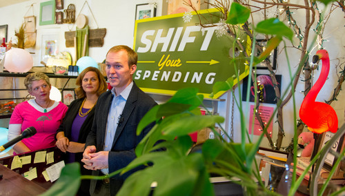 Trent Nelson     The Salt Lake Tribune Salt Lake County Mayor Ben McAdams encourages residents to ìShift Your Spendingî to local businesses this holiday season, during a press conference at The Old Flamingo in East Millcreek. Friday November 29, 2013. At right is Shauna Barrett, one of thirteen artists whose work is represented at the shop, and at center is Nan Seymour, executive director of Local First Utah.