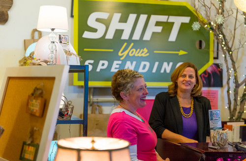 """Trent Nelson     The Salt Lake Tribune Artist Shauna Barrett, left, and Nan Seymour, executive director of Local First Utah, at The Old Flamingo in East Millcreek. Friday November 29, 2013. Salt Lake County Mayor Ben McAdams and Local First Utah are encouraging residents to """"Shift Your Spending"""" to local businesses this holiday season."""