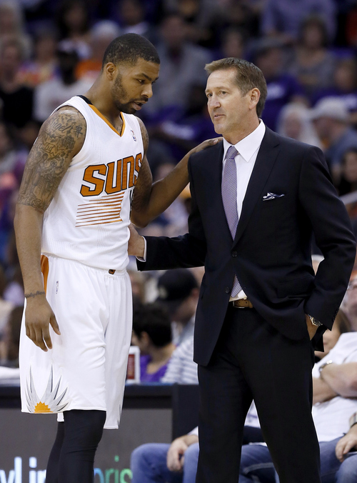 Phoenix Suns head coach Jeff Hornacek, right, talks with Marcus Morris during the second half in an NBA basketball game against the Portland Trail Blazers, Wednesday, Oct. 30, 2013, in Phoenix.  The Suns defeated the Trail Blazers 104-91. (AP Photo/Ross D. Franklin)