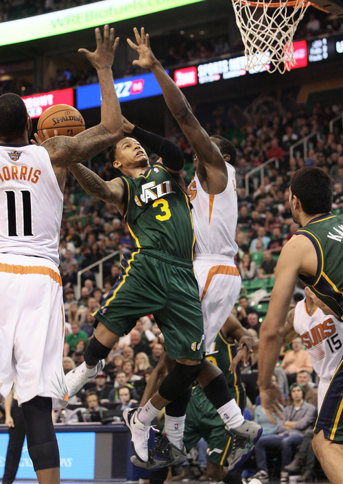 Scott Sommerdorf   |  The Salt Lake Tribune Utah Jazz G Trey Burke goes up for a layup during second half play, at Energy Solutions Arena, Friday November 29, 2013. The Suns beat the Jazz 112-101.