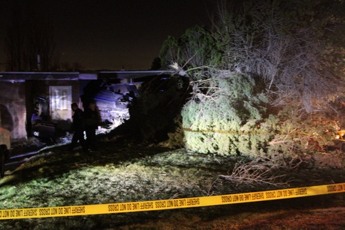 Kyle Kester  |  Special to the Tribune Emergency crews investigate the scene at about 4400 South Stratton Drive in Holladay where a driver careened into a home, leaving it uninhabitable. Authorities said there was a family present in the house, but nobody was injured.