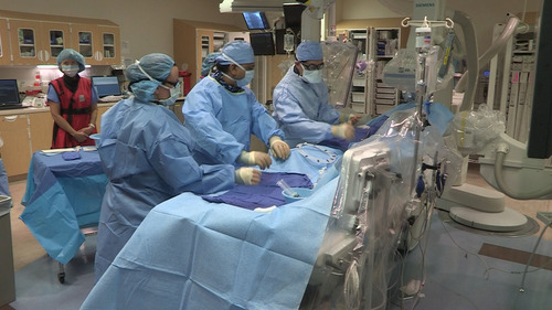 | Courtesy University of Utah Health Sciences University of Utah surgeon Amit Patel, far right, performs an experimental procedure using stem cells to treat heart disease on retired actor Ernie Lively of Heber City in November 2013.