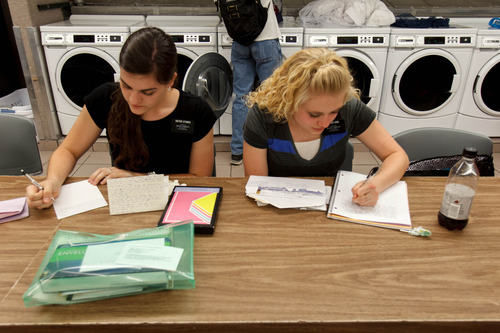 Trent Nelson  |  The Salt Lake Tribune Missionaries Amanda Stokes and Holly King write letters home while doing laundry at the LDS Missionary Training Center in Provo Tuesday June 18, 2013.