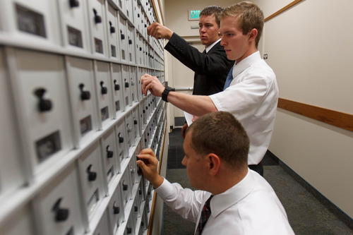 Trent Nelson  |  The Salt Lake Tribune Missionaries check for mail at the LDS Missionary Training Center  Tuesday June 18, 2013. Front to rear, Steven Johnson, Jonathan Wagstaff and Quincy Cox.