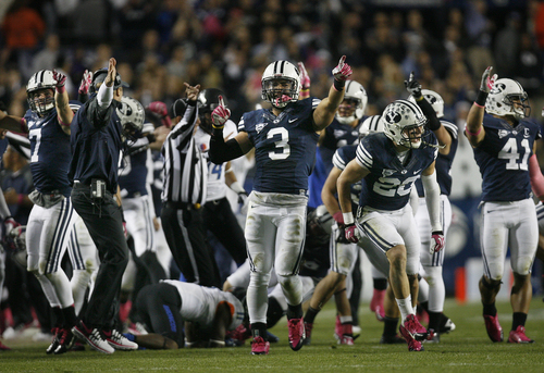 Scott Sommerdorf   |  The Salt Lake Tribune BYU LB Kyle Van Noy, 3, and other defensive players celebrate a fumble recovery late in the first half. BYU held a 24-3 lead over Boise State, Friday, October 25, 2013