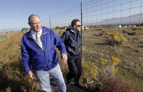 Al Hartmann  |  The Salt Lake Tribune Bluffdale City Manager Mark Reid, left, and Grant Crowell, city planner/economic development director, look over an 80-acre private-property parcel along Redwood Road north of the NSA Utah Data Center Oct. 15. The city would like to see the area developed into a commercial business center.