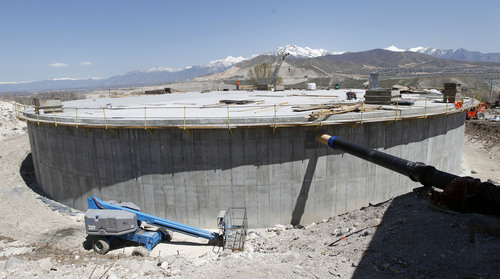 Al Hartmann  |  The Salt Lake  A 2 million gallon water tank nears completion in Bluffdale on April 24, 2013.  The tank will take water from the new National Security Agency facility at Camp Williams and use it as secondary water for Bluffdale's parks.