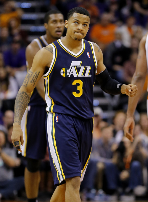 Utah Jazz guard Trey Burke (3) celebrates his basket against the Phoenix Suns during the second half of an NBA basketball game on Saturday, Nov. 30, 2013, in Phoenix. The Jazz won 112-104. (AP Photo/Matt York)