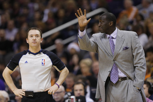 Utah Jazz head coach Tyrone Corbin, right, reacts to a call made by referee Scott Twardoski, left, during the first half of an NBA basketball game against the Phoenix Suns, Saturday, Nov. 30, 2013, in Phoenix. (AP Photo/Matt York)
