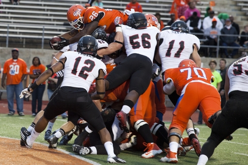 Keshawn Hill, 26, Sam Houston State running back goes over the top for a touchdown against Southern Utah during an NCAA college football gamein Huntsville, Texas Saturday, Nov. 30, 2013.  (AP Photo/The Huntsville Item, Matt Weintritt)