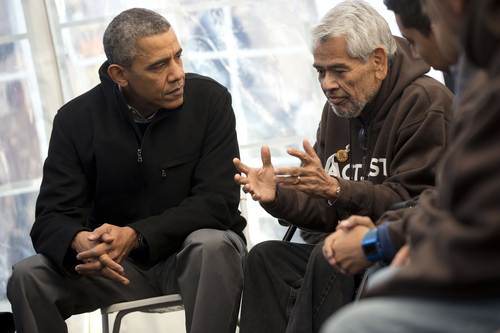 Pablo Martinez Monsivais  |  The Associated Press President Barack Obama, left, listens on Friday to Eliseo Medina, Secretary-Treasurer of Service Employees International Union, as he meets with individuals who are taking part in Fast for Families on the National Mall in Washington. Obama met with the group who are fasting on behalf of immigration reform.