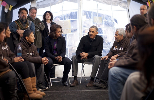 President Barack Obama and first lady Michelle Obama visit with individuals who are taking part in Fast for Families on the National Mall in Washington, Friday, Nov. 29, 2013. Obama met with the group who are fasting on behalf of immigration reform. (AP Photo/Pablo Martinez Monsivais)