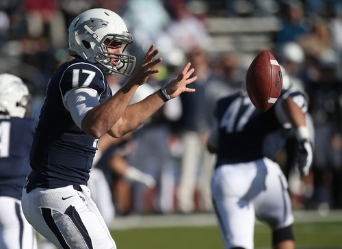 Nevada's Cody Fajardo (17) pitches the ball to a running back during the first half of an NCAA college football game in Reno, Nev., on Saturday, Nov. 30, 2013. (AP Photo/Cathleen Allison)