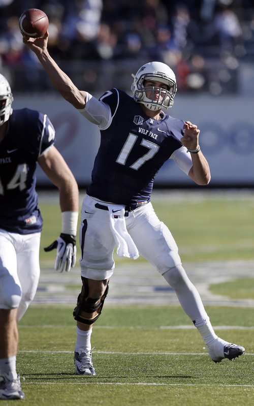 Nevada's Cody Fajardo (17) throws a pass against BYU during the first half of an NCAA college football game in Reno, Nev., on Saturday, Nov. 30, 2013. (AP Photo/Cathleen Allison)
