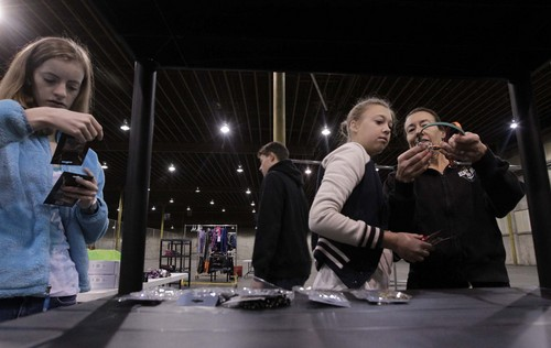 Leah Hogsten  |  The Salt Lake Tribune Mo Newlin, 14, and her mother, Eileen Newlin, try to determine how to wear a piece of jewelry while Ryann Gregory (left) works to display earring and necklace pairs at the Candy Cane Corner. Volunteers on Saturday set up this year's store, an annual collaboration between The Road Home, Volunteers of America, Utah and YWCA Utah. Parents in need can select donated gifts for their children plus clothing and housewares. The store opens Monday. Donations of new clothing, blankets and toys, plus cash donations, are being accepted.