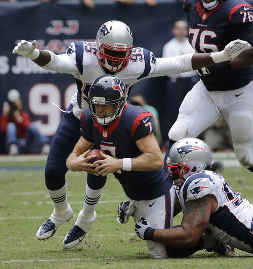 David J. Phillip | The Associated Press New England Patriots' Isaac Sopoaga, right, and Chandler Jones sack Houston quarterback Chase Keenum during the second half.