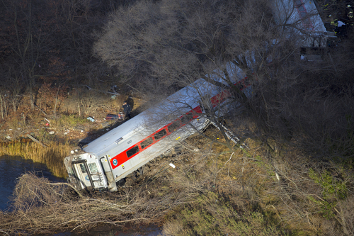 """First responders gather around the derailment of a Metro North passenger train in the Bronx borough of New York Dec. 1, 2013  The Fire Department of New York says there are """"multiple injuries"""" in the  train derailment, and 130 firefighters are on the scene. Metropolitan Transportation Authority police say the train derailed near the Spuyten Duyvil station. (AP Photo/Craig Ruttle)"""
