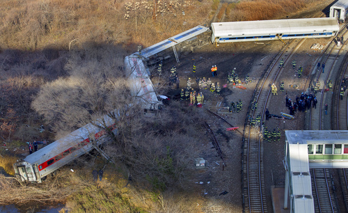 """First responders gather at the derailment of a Metro North passenger train in the Bronx borough of New York Sunday, Dec. 1, 2013  The Fire Department of New York says there are """"multiple injuries"""" in the  train derailment, and 130 firefighters are on the scene. Metropolitan Transportation Authority police say the train derailed near the Spuyten Duyvil station. (AP Photo/Craig Ruttle)"""