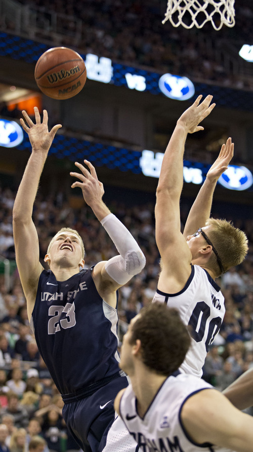 Lennie Mahler  |  The Salt Lake Tribune Utah State's Kyle Davis shoots over BYU's Eric Mika in the second half of their game at EnergySolutions Arena in Salt Lake City, Saturday, Nov. 30, 2013.