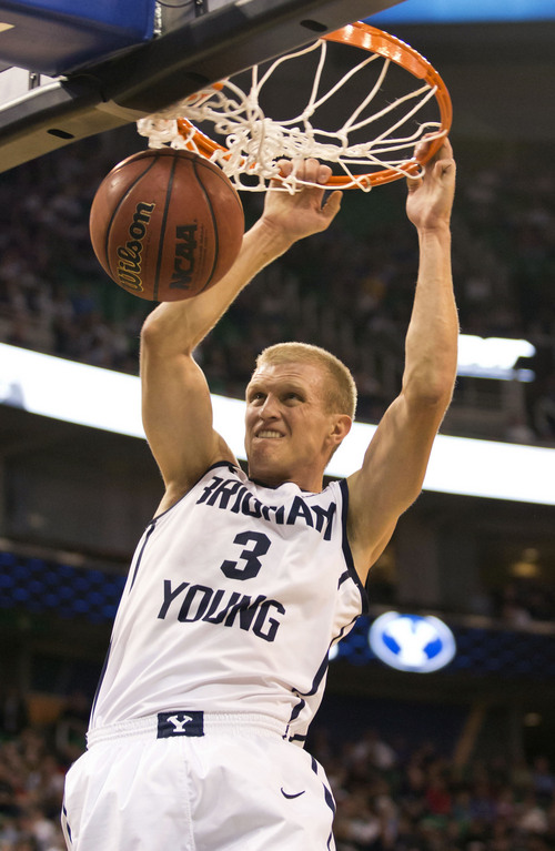 Lennie Mahler  |  The Salt Lake Tribune BYU's Tyler Haws dunks the ball in the first half of a game against Utah State at EnergySolutions Arena in Salt Lake City, Saturday, Nov. 30, 2013.