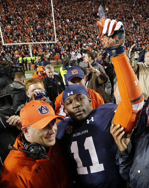 Auburn cornerback Chris Davis (11) celebrates after returning a missed field-goal attempt 100-plus yards to score the game-winning touchdown as time expired in the fourth quarter of an NCAA college football game against No. 1 Alabama in Auburn, Ala., Saturday, Nov. 30, 2013. Auburn won 34-28.(AP Photo/Dave Martin)