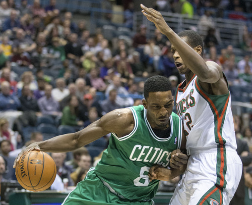 Milwaukee Bucks' Khris Middleton defends against Boston Celtics' Jeff Green during the first half of an NBA basketball game Saturday, Nov. 30, 2013, in Milwaukee. (AP Photo/Tom Lynn)