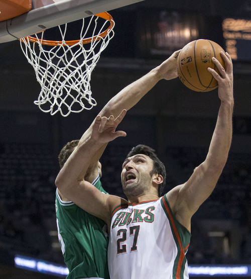 Milwaukee Bucks' Zaza Pachulia shoots over Boston Celtics' Kris Humphries during the second half of an NBA basketball game Saturday, Nov. 30, 2013, in Milwaukee. (AP Photo/Tom Lynn)