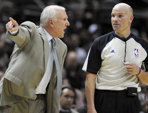 San Antonio Spurs head coach Gregg Popovich, left, argues with official Gary Zielinski during the second half of an NBA basketball game against the Houston Rockets, Saturday, Nov. 30, 2013, in San Antonio. Houston won 112-106. (AP Photo/Darren Abate)