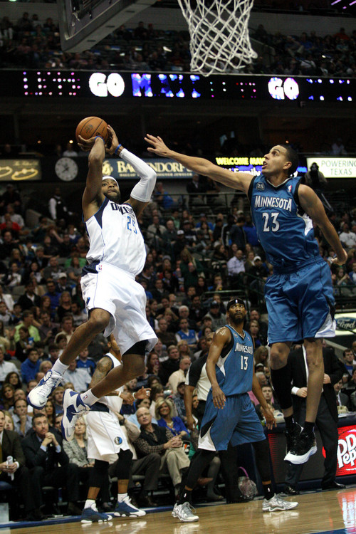 Dallas Mavericks shooting guard Vince Carter (25), left, shoots against Minnesota Timberwolves shooting guard Kevin Martin (23), right, during the first half of NBA basketball action at the American Airlines Center on November 30, 2013 in Dallas. (AP Photo/The Dallas Morning News, Sarah Hoffman)  MANDATORY CREDIT; MAGS OUT; TV OUT; INTERNET USE BY AP MEMBERS ONLY; NO SALES