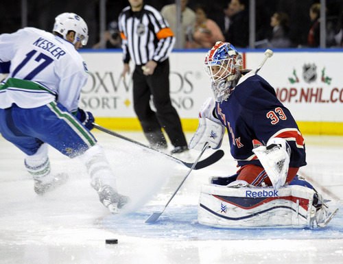 New York Rangers goaltender Cam Talbot, right, makes a save on a shot by Vancouver Canucks' Ryan Kesler during the first period of an NHL hockey game Saturday, Nov. 30, 2013, at Madison Square Garden in New York. (AP Photo/Bill Kostroun)