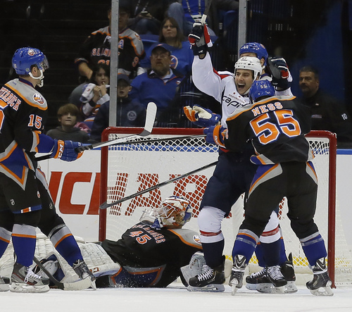 New York Islanders goalie Anders Nilsson (45) looks up from the ice as Washington Capitals left wing Aaron Volpatti (24) celebrates after scoring a goal during the second period of an NHL hockey game in Uniondale, N.Y., Saturday, Nov. 30, 2013. (AP Photo/Paul J. Bereswill)