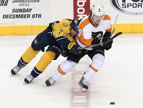 Philadelphia Flyers forward Steve Downie (9) and Nashville Predators forward Patric Hornqvist (27), of Sweden, battle for the puck in the second period of an NHL hockey game Saturday, Nov. 30, 2013, in Nashville, Tenn. (AP Photo/Mark Humphrey)