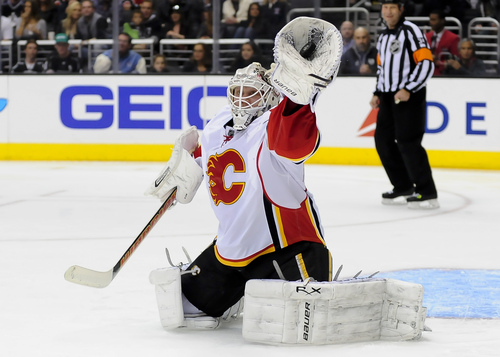 Calgary Flames goalie Karri Ramo, of Finland, catches the puck during the second period of an NHL hockey game against Los Angeles Kings, Saturday, Nov. 30, 2013, in Los Angeles. (AP Photo/Gus Ruelas)